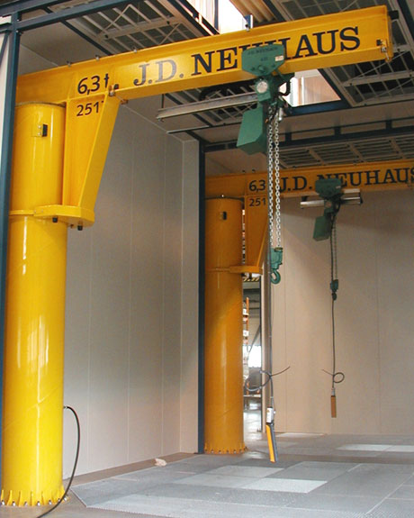 Typical slewing cranes supplied by J D Neuhaus, incorporating their air operated lifting hoists designated for safe operation in potentially explosive atmospheres